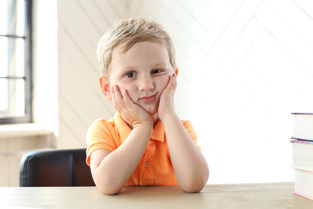 tired eyes: Child. Cute boy at home Stock Photo