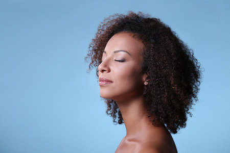 african american sexy: Beauty, skincare. Beautiful woman on a blue background