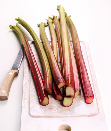 rheum: Food. Delicious garden rhubarb on the table