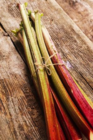 rheum: Food. Delicious garden rhubarb on the table