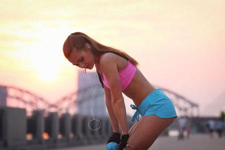 breathlessness: Sport outdoor. Beautiful girl on the street Stock Photo
