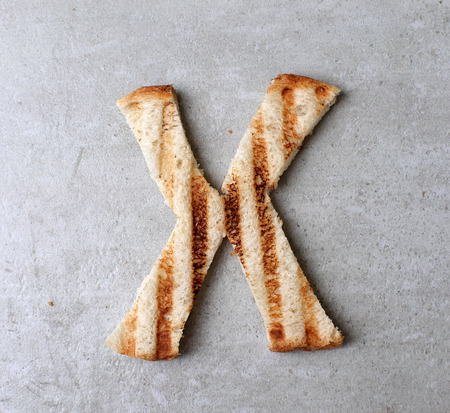 toasted: Toasted bread letters on the table
