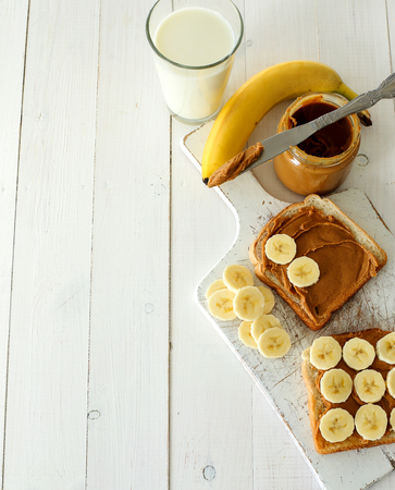 eating banana: Sweet food. Delicious peanut butter toast with banana