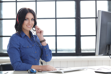 customer service representative: Job, secretary. Beautiful woman in the office Stock Photo
