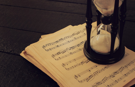 books on a wooden surface: Music notes on the table