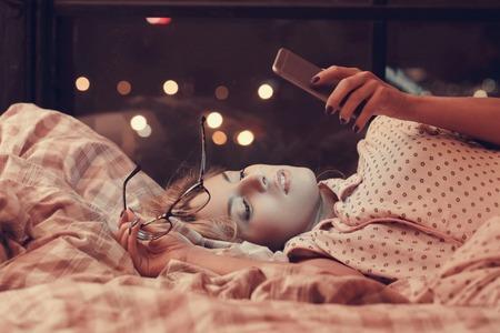 girl: Home. Girl lying in bed Stock Photo