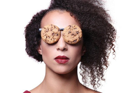 weird: Weird, crazy. Woman with glasses made out of cookies Stock Photo