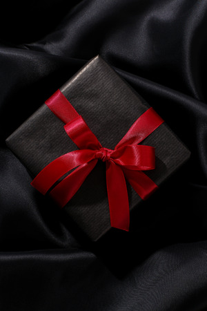 red gift box: Christmas, New Year. Wrapped gift on a black background Stock Photo