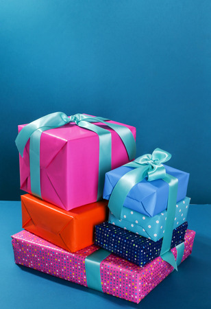 birthday presents: Christmas, New Year. Wrapped gifts on a blue
