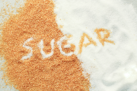 hyperglycemia: White and brown sugar on the table