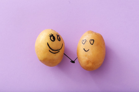 smile close up: Art. Funny potato on a purple background