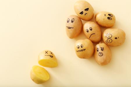 friend  nobody: Art. Funny potato on a yellow background Stock Photo