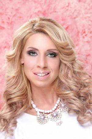 background pink: Beautiful woman on a pink background Stock Photo