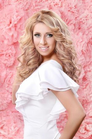 girl on a beautiful background: Beautiful woman on a pink background Stock Photo