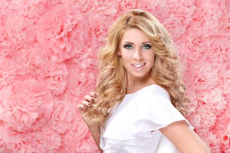 pink background: Beautiful woman on a pink background Stock Photo