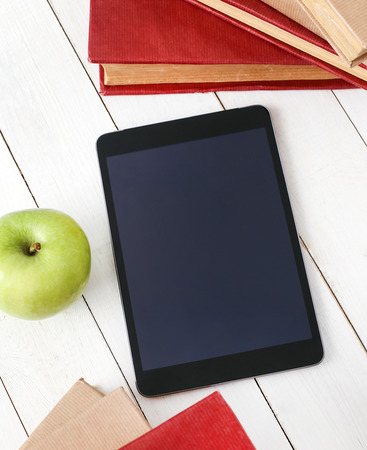 books on a wooden surface: Education. Books with tablet on the table