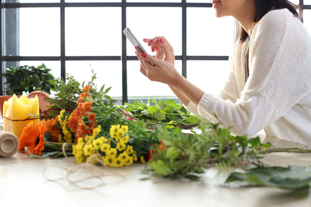 market gardener: Gardening. Woman with flowers at home Stock Photo