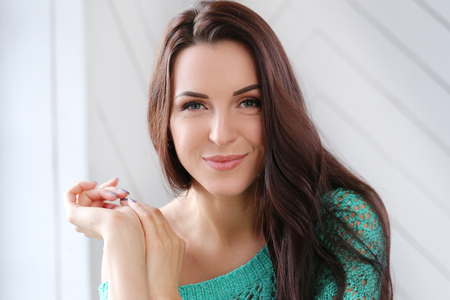 attractive gorgeous: Beautiful woman in green sweater Stock Photo
