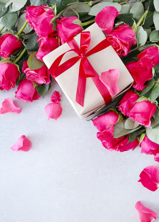 red gift box: Valentines day. Beautiful roses with a gift