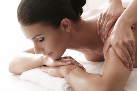 relaxation massage: Beautiful woman in spa salon