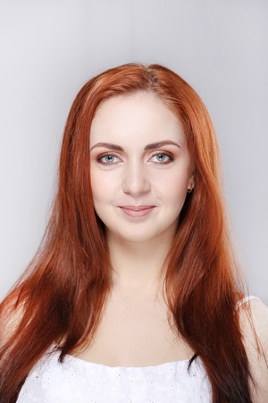 squint: Beautiful woman with red hair