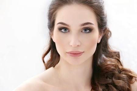 face shot: Beauty. Woman with cute makeup