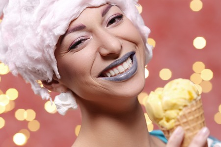 crazed: Weird. Woman in bizarre dress eats ice cream