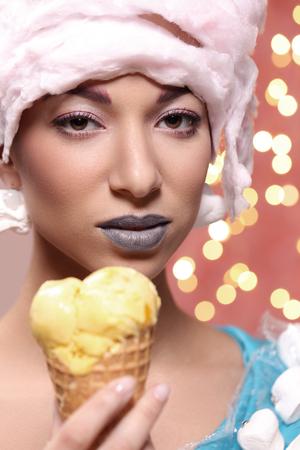 weird: Weird. Woman in bizarre dress eats ice cream