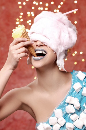 Weird. Woman in bizarre dress eats ice cream