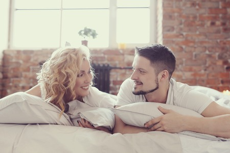 husband: Lifestyle. Beautiful couple in bed