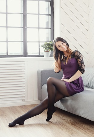 stocking: lifestyle. Lovely girl at home Stock Photo