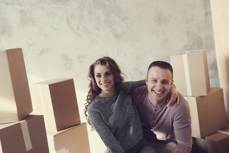 full house: Cute couple during moving home Stock Photo