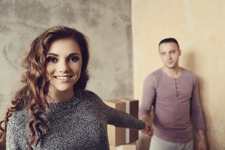 foreground focus: Cute couple during moving home Stock Photo