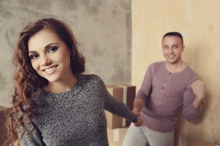 family moving house: Cute couple during moving home Stock Photo