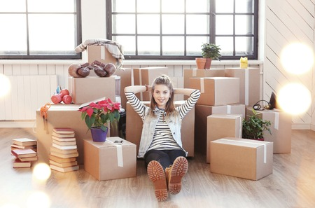 relocate: Cute girl during moving home Stock Photo