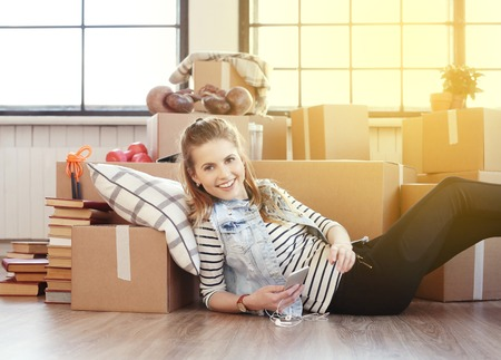 people moving: Cute girl during moving home Stock Photo