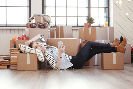 full house: Cute girl during moving home Stock Photo