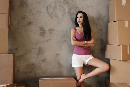 moving house: Cute girl during moving home Stock Photo