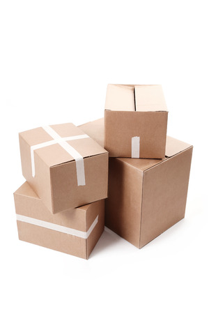 moving crate: Cardboard boxes on a white background Stock Photo