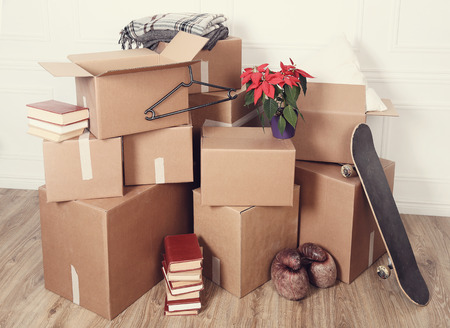 boxing tape: Moving home. Cardboard boxes on the floor
