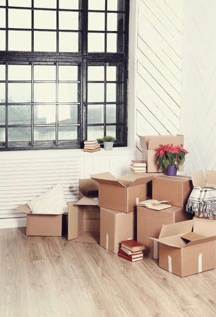moving crate: Moving home. Cardboard boxes on the floor