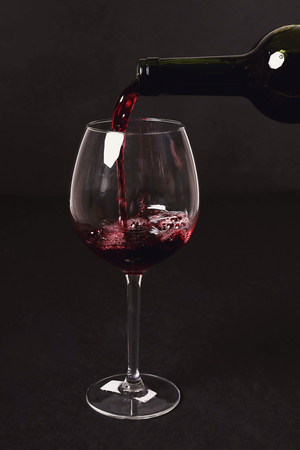 alcoholic drink: Alcoholic drink. Red wine pouring