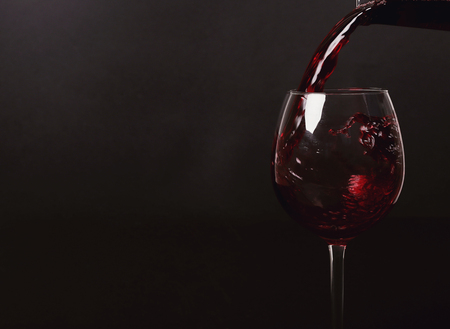 red wine pouring: Alcoholic drink. Red wine pouring