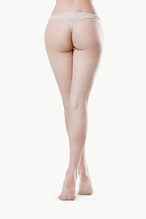 naked women: Beauty, spa. Woman legs on a white background Stock Photo