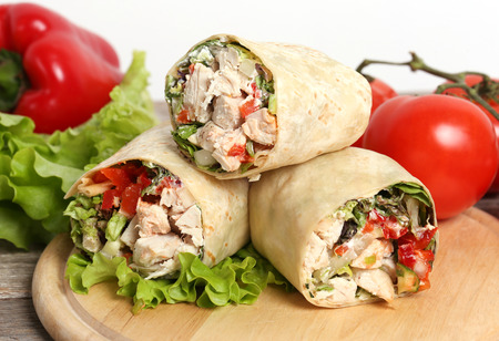 Healthy food. Delicious chicken wrap with vegetables