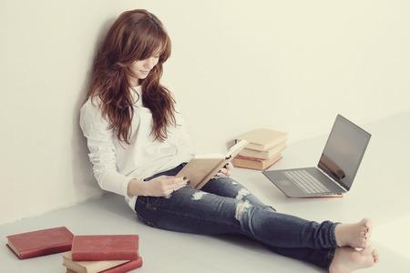 Lovely woman study on the floor