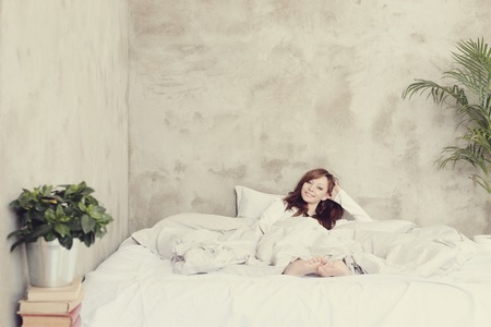 natural light: Beautiful woman in a bed