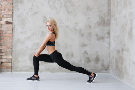 calisthenics: Gym. Woman with muscular body