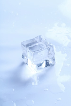 the frozen water: Frozen water. Ice cube on the table Stock Photo