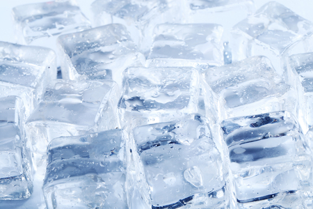 the frozen water: Frozen water. Ice cubes on the table Stock Photo